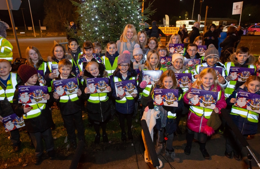 Esther with pupils from Lostock Gralam Primary School- and their selection boxes!